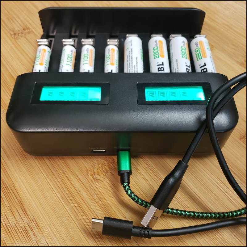 Battery charger with USB inputs for power.